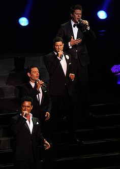 The well-established formation of Il Divo comprises a renowned Spanish baritone, Carlos Marín; two classically trained tenors, Swiss Urs Bühler and American David Miller; and a French pop singer, Sébastien Izambard.  Il Divo sings in Spanish, English, Italian, and French. Il Divo was named the Most Multinational UK No.1 Album Group in the 2006 edition of the Guinness Book of World Records.
