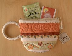 Quilted tea cup zippered pouch.  Love, love!