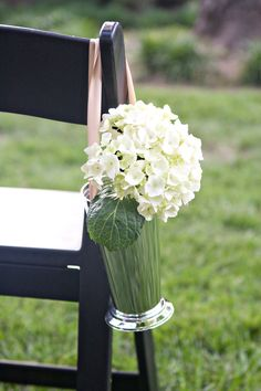Chair decorations for the ceremony: mint julep cups with hydrangeas tied with a champagne ribbon