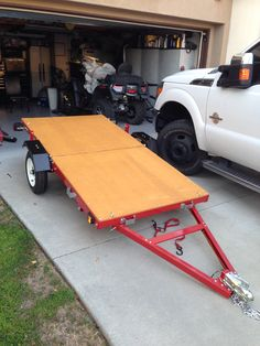 Nice folding trailer solves storage and transportation issues. Found it at Harbor Freight, assembly required, and plywood decking is additional. Very nicely made.