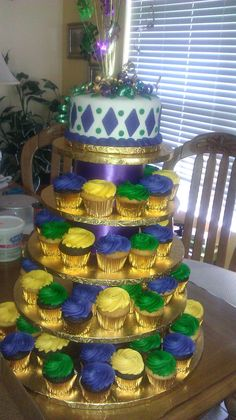 Mardi gras cake tower for our cake...then do a yummy groom's cake