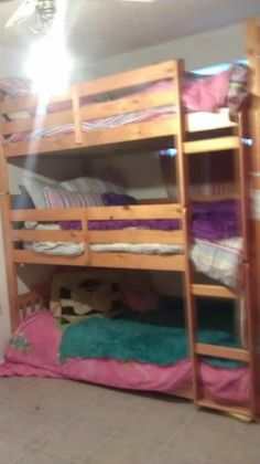 Clarissa Auringer    I got creative and made a triple bunk bed with 2 sets of walmart bunk beds. All it cost me was $15 for screws and brackets. I have 4 kids so my son got the bottom bed and I did this with the other three I thought I would share maybe give someone else the idea who needs it. These are so sturdy to, the bottom bed is not on the ground as it appears and all 3 of my girls, 6,8,10 can sit up right on their beds.