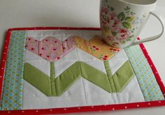 Amy Made That! ...by eamylove Spring tulips block from Quilty Fun, with a Cath Kidston mug.