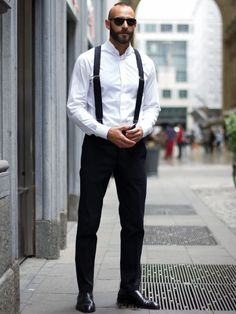 Shop this look on Lookastic:  http://lookastic.com/men/looks/sunglasses-dress-shirt-suspenders-dress-pants-oxford-shoes/10621  — Black Sunglasses  — White Dress Shirt  — Black Suspenders  — Black Dress Pants  — Black Leather Oxford Shoes