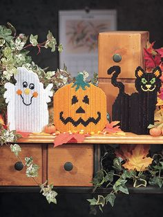 Plastic Canvas Halloween Patterns Set this black cat, ghost and jack-o-lantern threesome on a shelf or windowpane for a unique Halloween decoration. With their folding-style design, they stand on their own. All are made using 7-count plastic canvas and #4 worsted-weight yarn.  (aff link)