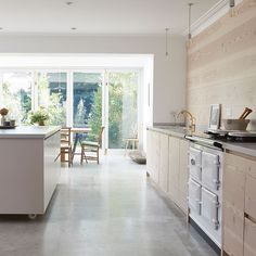 Clean-lined white kitchen island and polished concrete floor in a Scandinavian pale wood kitchen in London by Blakes London and House of Grey Kitchen Cabinetry, Kitchen Flooring, Kitchen Dining, Aga Kitchen, Round Kitchen, Kitchen Units, Open Kitchen, Dining Area, Dining Room