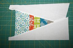 Ok, finally! Look what I have for you… a quick little tutorial on how to construct the scrappy triangle blocks I used in my Nautical quilt. A few things before we start… this tutorial w…