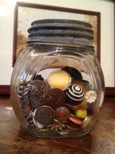 Old jar filled with vintage buttons
