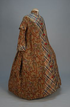 Robe: 1950's, mushroom wool with taffeta trim, collared sleeve/cuff/yoke and front panel in plaid taffeta, silk frogs, polished cotton lining.