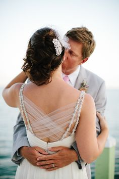 Love the intricate back of this wedding dress  Photography: Becca Borge Photography - beccaborge.com  Read More: http://www.stylemepretty.com/southeast-weddings/2014/04/22/florida-keys-beach-wedding-at-drop-anchor-resort/