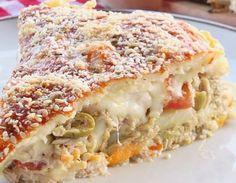 Essa Torta com sobras de Arroz você pode colocar o recheio que quiser e ideal para servir como aperitivo.