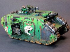 Warhammer 40k Salamanders Space Marines Land Raider. I really like the skull added to the side, and the mechanicum shoulder plate - great paint and weathering work too, shame the pic is so blurry