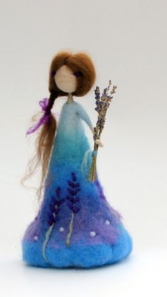 Needle felted Waldorf inspired standing doll. Ready to ship now. Thank you for visiting my shop!! Please see my shop policies for more information: http://www.etsy.com/shop/Made4ubymagic/policy Design by Zuzana Hochman. Needle felted doll, Lavender, Waldorf doll, the lavender doll,