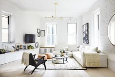 "Once you see Roth's own chic-to-death NYC apartment you'll understand why her minimal-loving client's tracked her down and this stylish, light-filled living room is a prime example. ""My style is..."