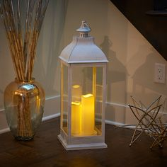 "Avalon 28"" Triple LED Candle Lantern in Antique White #WhiteLantern #BatteryPowered #CandleLantern #SmartLivingHG #InteriorDecor #OutdoorDecor #IndoorOutdoorFriendly"