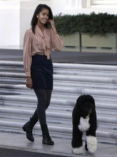 Malia Obama and First Dog Bo I love how she throws on combats with such an upscale outfit very unique