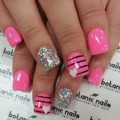 Barbie pink nails with stripes and glitter! Feel fun and flirty in pink with nail polish from Beauty.com. #beautynails