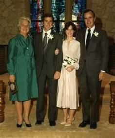 Wedding photo of George W. and Laura Bush flanked by his parents Barbara and George H. W. Bush.