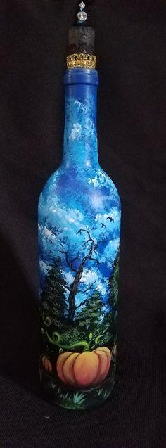 Pumpkin painting on wine bottle by Jennifer Busse.