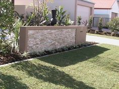 feature letterbox - front garden landscaping Alexander Landscapes - Sunshine Coast