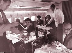 The lap of Luxury: Passengers tuck in for their in-flight meal in the first class cabin of...