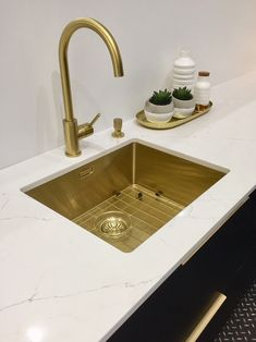 A new kitchen should make your heart sing - these elegant brassy tones certainly add some wow!
