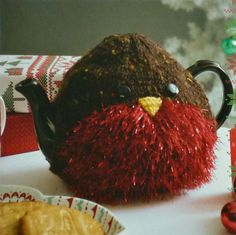 Knitted by my own fair hands this Robin Red Breast Seasonal Christmas Tea Cosy would grace any festive table - just the unique present for someone who has everything to make Christmas just that bit special.  Its made from Tinsel Chunky (Bulky) and Tweed Chunky yarns. Although this is done in traditional Robin colours for Christmas you can have it in any colour you like to match your Christmas colour scheme. Available in 19 solid and multi shades of Tinsel and 8 shades of Chunky Tweed. This…