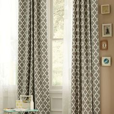 Grey lattice curtains, similar to what I bought. Or should I keep the teal instead? Combined with a taupe wall and mismatched art frames in natural tones