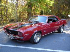 1969 Chevy Camero SS I had this car in orange , white stripes and interior and 3 on the tree