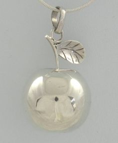 Harmony Ball - APPLE - Sterling Silver Item 1105831771 Top marks for this shiny apple! Sterling silver, looks beautiful and sounds amazing too. An apple for a teacher, doctor, Eve (or Adam) or anyone in your life who could do with a little harmony.