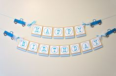 This listing is for a two-tiered banner with 4 trucks and the text HAPPY and BIRTHDAY matching the Little Blue party collection from our shop.