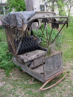 Looks like an old Victorian carriage for a horse drawn wagon...It's in need of serious repair...or not. horses, coach, hanging flowers, pink houses, horsedrawn carriag, abandon, forgotten, thing, halloween