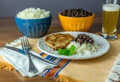 A recipe for Chuletas: Latin American  pork chops along with black beans and rice. | Ethnicspoon.com