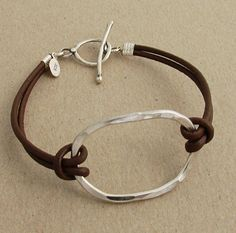 Large hammered sterling oval bracelet on brown leather