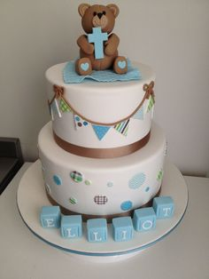 Christening / Baptism - Christening cake. Bunting and circles made from edible scrapbook paper. Teddy bear and blocks made from fondant.