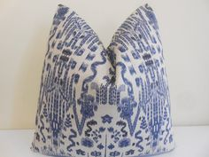 Ikat pillow cover in indigo on an oatmeal background  Both sides have the same fabric. Fabric: 100% Cotton .  Size:..............18 x 18, 20 x 20,