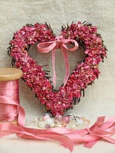 pink floral heart wreath and pink ribbons