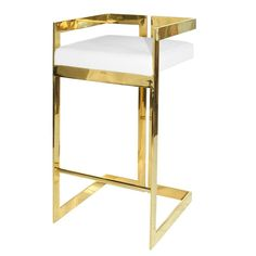 Linear bar stool with brass base and white leather cushion.