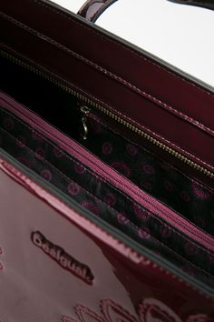 This bordeaux rogue shopper bag with etched mandala details will get a lot of attention… so keep it close!