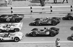 On the grid for the 1965 Riverside 200. Left to right going down: Bob Bondurant in a Lola T70, Hap Sharp in the Chaparral, Graham Hill in a McLaren Elva, Richie Ginther in a Lotus 40 and Jim Clark in a Lotus 40. Hall was a no-start due to suspension trouble with the 2C. Sharp would win, Clark was 2nd. Albert R. Bochroch photo.