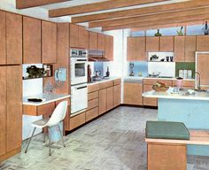 An Eichler-style roof line with wood beams. Wood nicely carried through to the cabinets, which have plain slab doors. Notice also the two different colors used on the backsplash at the back. Hint of Mondrian.