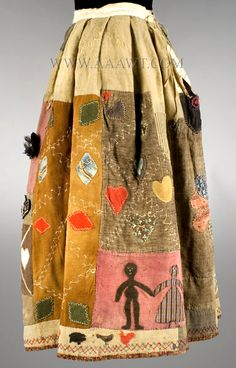 Assembled from early to mid 19th C. scraps of homespun wool, prints, yarn and more, all hand sewn, this Story Skirt is reminiscent of the wonderful African American Quilts made by Harriet Powers in the late 19th Century. (more photos)