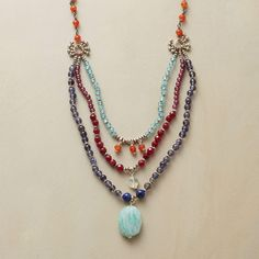 TATI NECKLACE--Separated by sterling silver beads, a single strand branches into three, each dangling a centerpiece. Handmade exclusive with red jade, iolite, apatite, turquoise, prehnite, garnet, and carnelian