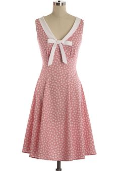 """Medium pink dress with sailor-like V-collar and self-tie bow. Full swing skirt. 37"""" long. $95."""