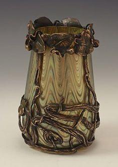 Loetz Art Nouveau Irridescent Glass Vase with Bronze Mount:  Manufacturer - Loetz Designer - ? Description - Irridescent glass vase with               bronze Art Nouveau mount Country of Manufacture - Austria Date - c.1905 Condition - Perfect Size - 13.5cms high