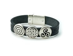 "Attaching with a magnetic closure, you will never need to ask for help when taking this bracelet on or off, as all it takes is one hand! The magnetic closure will keep the bracelet snapped safely and securely! Available in two lengths, 7"" or 7 ½"", this bracelet will surely fit most anyone! The Celtic charm bracelet is beautifully crafted from high quality leather. Made in Co. Cork, Ireland."