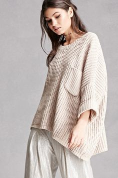 An oversized fleece ribbed knit sweater featuring a round neckline, short cuffed dolman sleeves, a chest pocket, and a flowy silhouette. This is an independent brand and not a Forever 21 branded item.