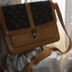 Authentic LV Bag Unusual shoulder bag,  inside is like new condition and backside looks new too.  I did not polish the front cause the price would go up.  I still might keep this if I cannot get a good price.  Some one took very good care of this bag. Louis Vuitton Bags