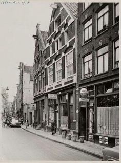 1957. A view of the Zeedijk in Amsterdam. The runs from the Prins Hendrikkade to the Nieuwmarkt. The Zeedijk is also the heart of the Chinese neighborhood. Today, there are many stores and restaurants in the street. The Bocht van de Zeedijk was in the 17th century one of the most respectable places where one could live. After the construction of the Herengracht many rich merchants moved and the area became an entertainment area for sailors. #amsterdam #1957 #Zeedijk