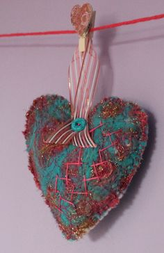Needle felted blue heart with hand stitching by Sheila Hodson.